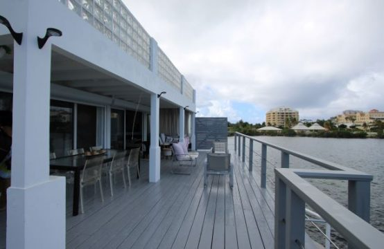 Point Pirouette Water front condo with outdoor dining and lounge areas